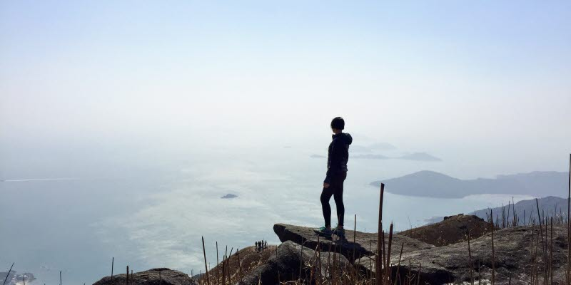 Silhouette of a human on a cliff