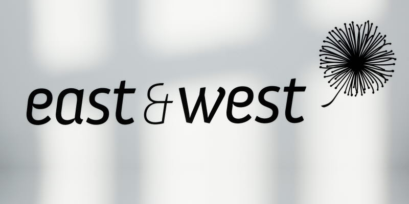 East and West logo