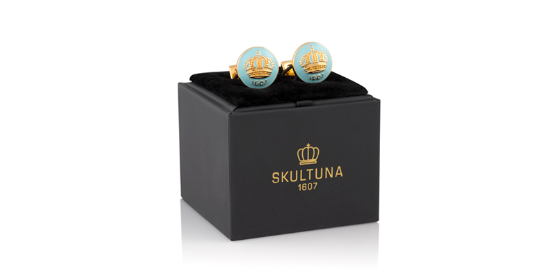 Green cuffslinks with a yellow crown