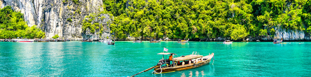 Boat on tuquiose water in thailand