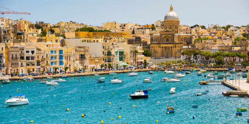 Boats in the water outside Valetta in Malta