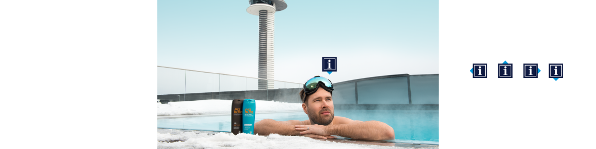 A man in a pool with a flight tower in the background