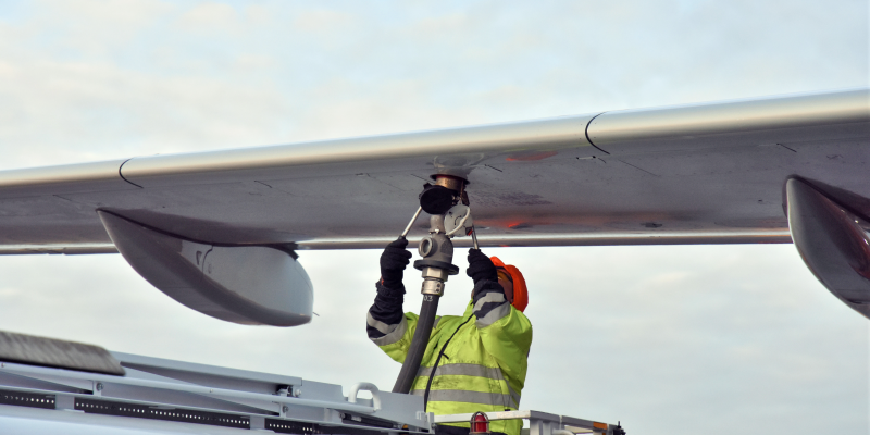 Crew refueling an aircraft with biofuel
