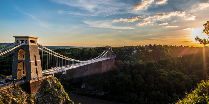 Clifton Suspension Bridge, Bristol, UK with sunset and sunbeams