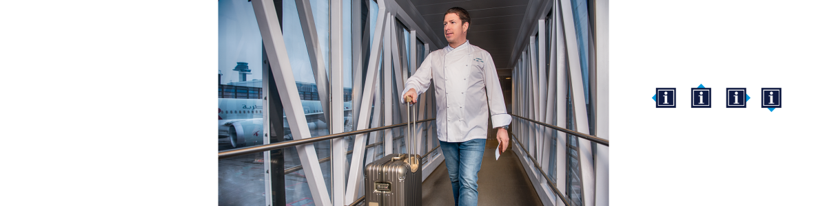 A chef in a bridge with a suitcase